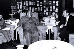 Mao Zedong and Zhou Enlai in a meeting with Richard Nixon, President of the United States, in February 1972. The second from left was the interpreter Tang Wensheng.