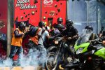 Volunteer rescuers step aside to take cover as riot police motorcyclists charge on opposition activists protesting against the newly inaugurated Constituent Assembly in Caracas, Venezuela. 4 August 2017.