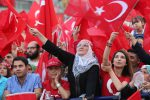 People wave Turkish national flags as they gather on at Kizilay Democracy Square in Ankara during a rally against the failed military coup of 15 July 2016. 10 August 2016.