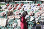 Girl passing by posters of candidates of Iran's Parliamentary Election in Tehran, Iran. 21 February 2016.